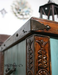 ***SOLD***Turquoise and Dark Stain Distressed Chest. Rich color and beautiful carved detail. Original hardware with soft close hinges.