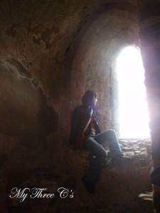 Model (Jessica Gatrate) admiring the view from Framlingham Castle.  Framlingham, Norfolk, England
