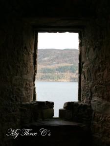 The Loch through a window of Urquhart Castle.  Loch Ness, Scotland.